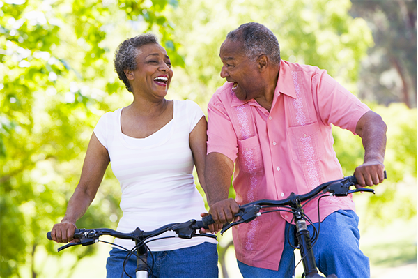 Signify Office African American couple riding bikes together